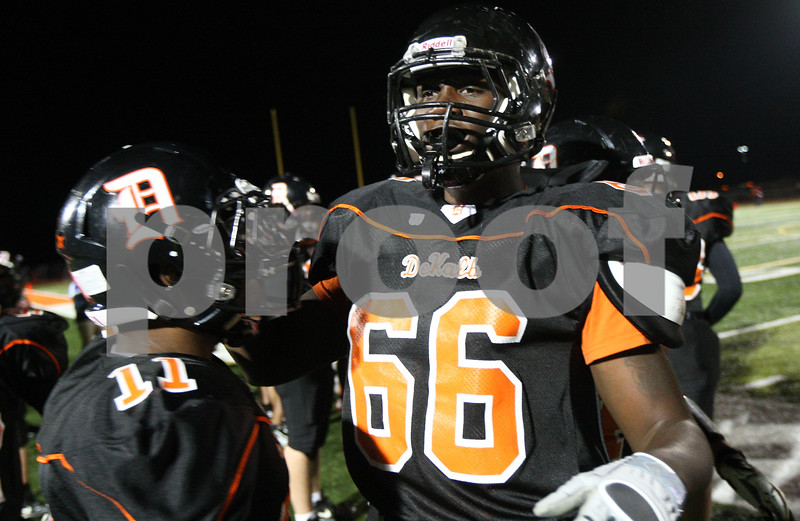 Kyle Bursaw – kbursaw@shawmedia.com<br /> <br /> Defensive lineman Jonathon Bell returns to the sidelines with the rest of the Barbs defense after Bell recovered a fumble in the first quarter against Yorkville at DeKalb High School on Friday, Oct. 12, 2012.