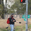 Kyle Bursaw – kbursaw@shawmedia.com<br /> <br /> Eric Carlson waits for the light to turn at Peace Road and Barber Greene Road while running a few errands before work on Tuesday, Oct. 9, 2012.