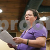 Rob Winner – rwinner@shawmedia.com<br /> <br /> Thelma Holderness reads a poem during a gathering to remember Toni Keller at the DeKalb Elk's Lodge on Wednesday evening. It has been nearly two years since Keller's death.