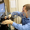 Rob Winner – rwinner@shawmedia.com<br /> <br /> Ryan Hopper accesses the server that controls the new digital projectors from the main office at the Sycamore State Theater Saturday afternoon.