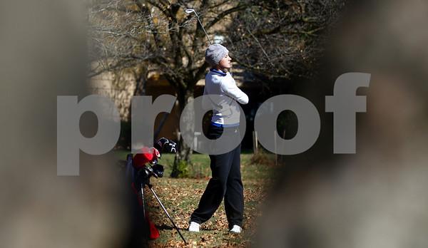 Kyle Bursaw – kbursaw@shawmedia.com<br /> <br /> Genoa-Kingston's Andrea Strohmaier <br /> takes a shot on the second hole of the Oak Club in Genoa, Ill. on Monday, Oct. 8, 2012.