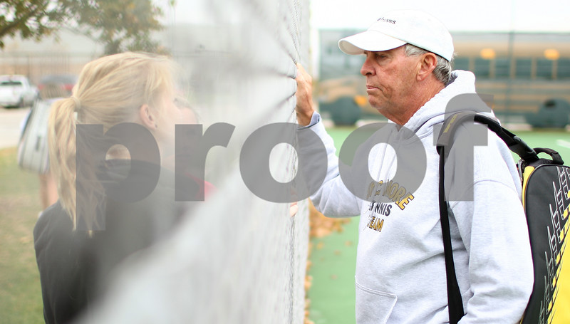 Kyle Bursaw – kbursaw@shawmedia.com<br /> <br /> Sycamore tennis coach Dave Hillmer talks to player Lauren Lundbeck through the fence at the end of practice on Tuesday, Oct. 9, 2012.