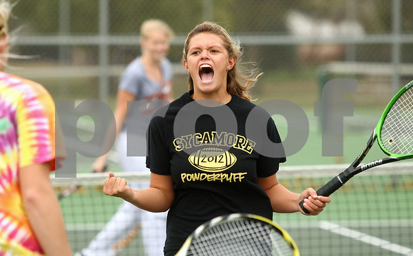 Kyle Bursaw – kbursaw@shawmedia.com<br /> <br /> Sycamore's Aspen Paulsen reacts to making a tough shot at practice on Tuesday, Oct. 9, 2012.
