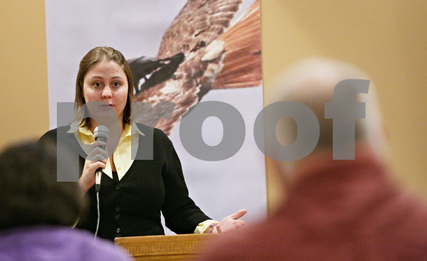 Rob Winner – rwinner@shawmedia.com<br /> <br /> Laura Devine speaks at a gathering to remember Toni Keller at the DeKalb Elk's Lodge on Wednesday evening. It has been nearly two years since Keller's death.