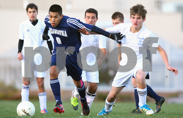 Kyle Bursaw – kbursaw@shawmedia.com<br /> <br /> Hiawatha's Poncho Garcia dribbles away from Chicagoland Jewish players in the first half of the Class 1A Genoa-Kingston Regional Semifinal at Genoa-Kingston High School on Wednesday, Oct. 10, 2012.