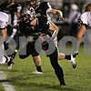 Rob Winner – rwinner@shawmedia.com<br /> <br /> Kaneland running back Jesse Balluff (30) carries the ball for a 10-yard touchdown run during the second quarter in Maple Park Friday, Oct. 12, 2012.