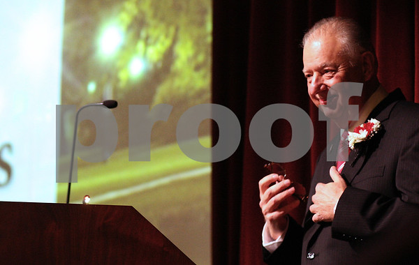 Kyle Bursaw – kbursaw@shawmedia.com<br /> <br /> Northern Illinois University President John Peters puts away his reading glasses as he finishes what will likely be his last State of the University address on Thursday, Oct. 11, 2012. In his address Peters announced that his last day as president would be June 30, 2013.