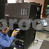Rob Winner – rwinner@shawmedia.com<br /> <br /> Ryan Hopper demonstrates how to load hard drives containing feature length movies into the new digital projectors at the Sycamore State Theater Saturday afternoon.