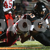 Kyle Bursaw – kbursaw@shawmedia.com<br /> <br /> Yorkville linebacker Brian McCue can't stop DeKalb running back Dre Brown as he tumbles in for a touchdown to put the Barbs up 6-0 in the first quarter at DeKalb High School on Friday, Oct. 12, 2012.