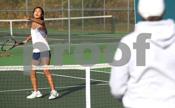 Kyle Bursaw – kbursaw@shawmedia.com<br /> <br /> Sycamore's Angelina Ye gets ready to return a ball from coach Dave Hillmer (right) during practice on Tuesday, Oct. 9, 2012.