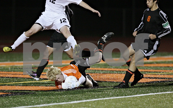 Rob Winner – rwinner@shawmedia.com<br /> <br /> DeKalb goalkeeper Cully Hicks makes a save in the second half of the Class 3A DeKalb Regional semifinal on Tuesday, Oct. 16, 2012. DeKalb defeated Jacobs, 1-0.