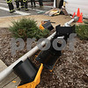 Kyle Bursaw – kbursaw@shawmedia.com<br /> <br /> Firefighters clean up the area of an accident which knocked down a street light at the corner of Highway 23 and Barber Greene Road on Thursday, Oct. 18, 2012.