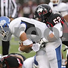Rob Winner – rwinner@shawmedia.com<br /> <br /> Buffalo quarterback Alex Zordich (left) is sacked by Northern Illinois linebacker Michael Santacaterina (52) during the third quarter in DeKalb, Ill., Saturday, Oct. 13, 2012. NIU defeated Buffalo, 45-3.