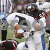Rob Winner – rwinner@shawmedia.com<br /> <br /> Buffalo quarterback Alex Zordich (left) is sacked by Northern Illinois linebacker Michael Santacaterina (52) during the third quarter in DeKalb, Ill., Saturday, Oct. 13, 2012. NIU defeated Buffalo, 45-3.