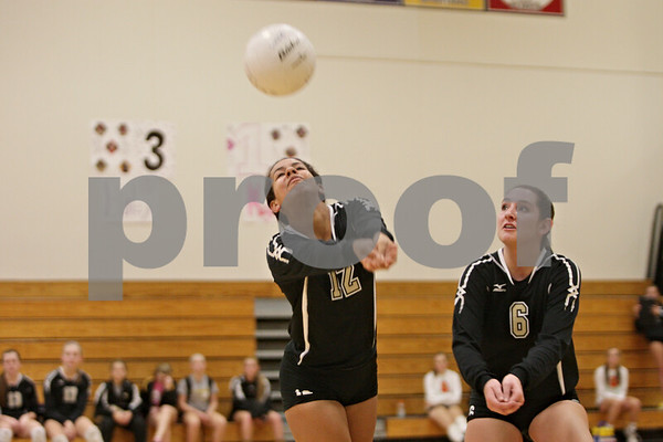Rob Winner – rwinner@shawmedia.com<br /> <br /> Sycamore's Mattie Hayes (12) bumps a ball ahead of teammate Hannah Knox (6) during the second game in Rochelle Thursday, Oct. 18, 2012. Sycamore defeated Rochelle, 25-14 and 25-14.