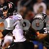 Kyle Bursaw – kbursaw@shawmedia.com<br /> <br /> DeKalb wide receiver Drew Paszotta tries to shake off Kaneland linebacker Jesse Balluff in the first quarter of the game at Kaneland High School on Friday, Sept. 28, 2012.