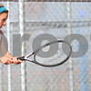 Kyle Bursaw – kbursaw@shawmedia.com<br /> <br /> DeKalb senior Taylor Volk (left) returns a ball from assistant tennis coach Michael O'Neill during a one-on-one practice at DeKalb High School on Tuesday, Oct. 16, 2012.