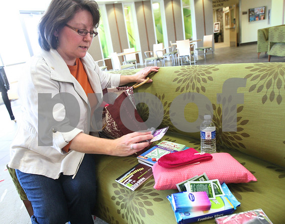 Kyle Bursaw – kbursaw@shawmedia.com<br /> <br /> Cheryl Chilson, of Positively Pink Packages shows the contents of one of her care packages for breast cancer patients on a couch in the lobby of the Kishwaukee Community Hospital Cancer Center on Tuesday, Oct. 16, 2012.