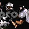 Kyle Bursaw – kbursaw@shawmedia.com<br /> <br /> DeKalb defensive lineman Jake Smith sacks Kaneland quarterback Drew David in the first quarter of the game at Kaneland High School on Friday, Sept. 28, 2012.