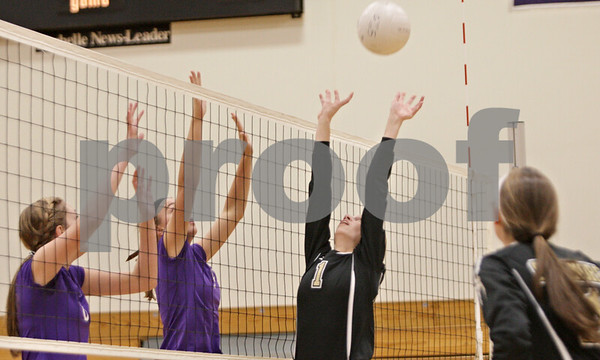 Rob Winner – rwinner@shawmedia.com<br /> <br /> Sycamore's Kendra Larson (1) sets a ball during the second game in Rochelle Thursday, Oct. 18, 2012. Sycamore defeated Rochelle, 25-14 and 25-14.