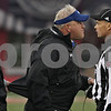 Rob Winner – rwinner@shawmedia.com<br /> <br /> Buffalo coach Jeff Quinn (center) gets into the face of an official after a fourth down run play in the second quarter. Quinn did not like where the ball was placed, however after a measurement Buffalo received a first down in DeKalb, Ill., Saturday, Oct. 13, 2012. NIU defeated Buffalo, 45-3.