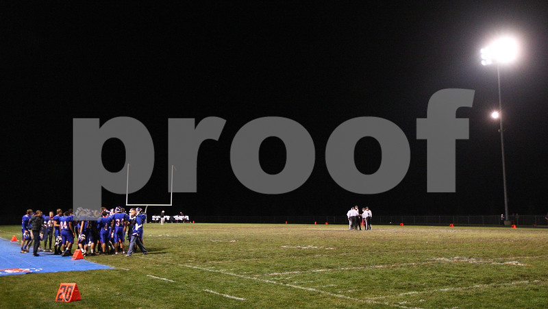 Kyle Bursaw – kbursaw@shawmedia.com<br /> <br /> The Cogs huddle before the start of their final game of 2012 against Marengo at Genoa-Kingston High School on Friday, Oct. 19, 2012.