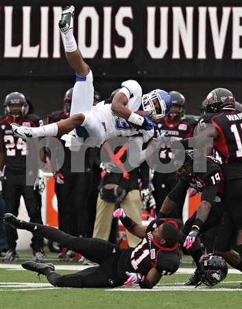 Rob Winner – rwinner@shawmedia.com<br /> <br /> Buffalo wide receiver Devon Hughes (13) is upended by Northern Illinois cornerback Rashaan Melvin (11) during the first quarter in DeKalb, Ill., Saturday, Oct. 13, 2012. NIU defeated Buffalo, 45-3.