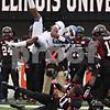 Rob Winner – rwinner@shawmedia.com<br /> <br /> Buffalo wide receiver Devon Hughes (13) is upended by Northern Illinois cornerback Rashaan Melvin (11) during the first quarter in DeKalb, Ill., Saturday, Oct. 13, 2012. NIU defeated Buffalo, 45-3.