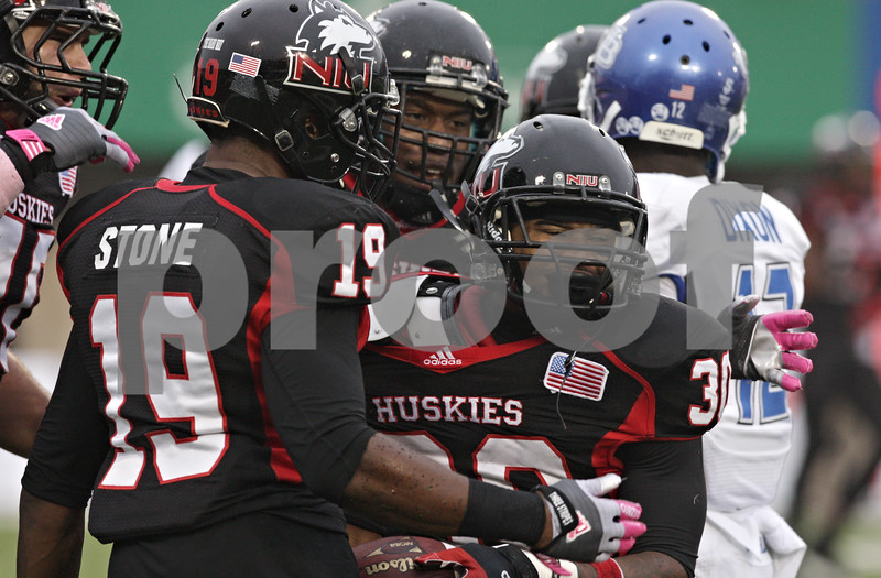 Rob Winner – rwinner@shawmedia.com<br /> <br /> Northern Illinois cornerback Marlon Moore (30) celebrates with his teammates after making an interception during the third quarter in DeKalb, Ill., Saturday, Oct. 13, 2012. NIU defeated Buffalo, 45-3.