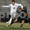 Rob Winner – rwinner@shawmedia.com<br /> <br /> Jacobs' Kenny Finn (10) and DeKalb's Trevor Freeland struggle for a ball in the first half of the Class 3A DeKalb Regional semifinal on Tuesday, Oct. 16, 2012. DeKalb defeated Jacobs, 1-0.