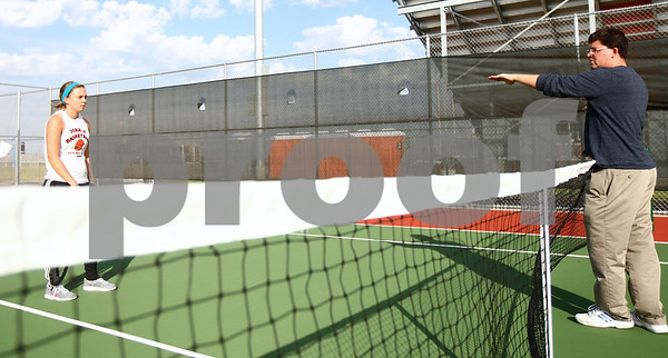 Kyle Bursaw – kbursaw@shawmedia.com<br /> <br /> DeKalb senior Taylor Volk (left) gets advice from assistant tennis coach Michael O'Neill during a one-on-one practice at DeKalb High School on Tuesday, Oct. 16, 2012.
