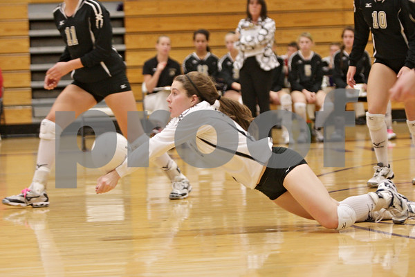 Rob Winner – rwinner@shawmedia.com<br /> <br /> Sycamore libero Christina Dailey dives for a ball during the second game in Rochelle Thursday, Oct. 18, 2012. Sycamore defeated Rochelle, 25-14 and 25-14.