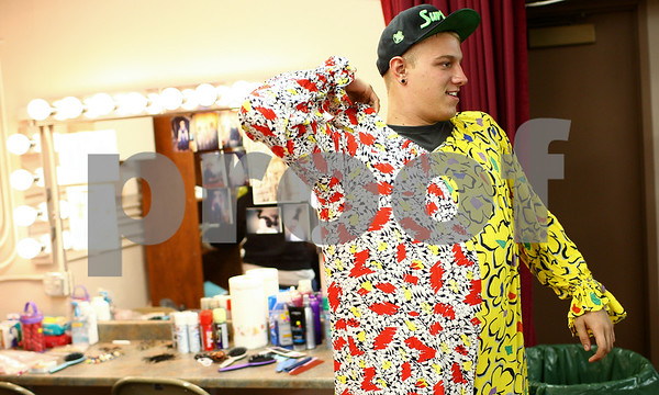 Kyle Bursaw – kbursaw@shawmedia.com<br /> <br /> Dylan Hughes, 19, adjusts the outfit for his clown costume in the dressing area of the Egyptian Theatre in DeKalb, Ill. before performing in the Amenti Haunted House on Friday, Oct. 19, 2012. The event runs Oct. 20th, 26th, 27th and 31st from 7 p.m. to 11:30 p.m. and Oct. 21st, 28th and 30th from 7 p.m. to 10 p.m.