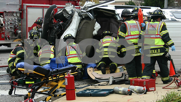 David Thomas — dthomas@shawmedia.com<br /> <br /> Firefighters work to extract a man from an overturned van on the corner of Highway 23 and Barber Greene Road on Thursday, Oct. 18, 2012.