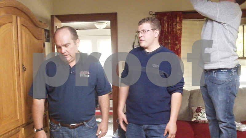 """Homeowner Mark Denia (right) goes over a scene with Richard Trethewey, a plumbing and HVAC expert on the home improvement show """"Ask This Old House."""""""