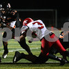 Kyle Bursaw – kbursaw@shawmedia.com<br /> <br /> DeKalb running back Dre Brown finds space as Yorkville linebacker Brian McCue tries to make the tackle in the second quarter at DeKalb High School on Friday, Oct. 12, 2012.