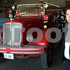 Kyle Bursaw – kbursaw@shawmedia.com<br /> <br /> Lieutenant Luke Howieson, one of the members of the DeKalb Fire Fighters Historical Foundation, stands with the 1951 Mack fire truck donated by Bob Kyler in one of the DeKalb Fire Department's storage areas at the DeKalb Taylor Municipal Airport on Monday, Oct. 15, 2012.