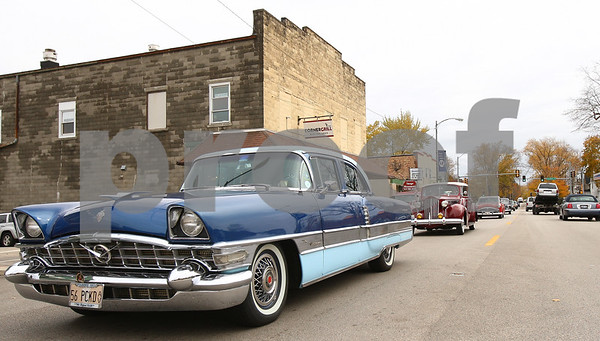 Kyle Bursaw – kbursaw@shawmedia.com<br /> <br /> Ray Bacci drives a 1956 Packard Patrician west through Genoa, Ill. with his wife Gail Bacci. Members of the Packard Car Club drove their cars through the town and then stopped for lunch at Crumpet's Tea Room on Thursday, Oct. 18, 2012.