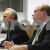 Rob Winner – rwinner@shawmedia.com<br /> <br /> Republican Clay Campbell (left) speaks as Democrat Richard Schmack listens at the League of Women Voters of Dekalb County Candidates' Night at DeKalb City Hall Wednesday, Oct. 17, 2012. Campbell and Schmack are running for state's attorney.