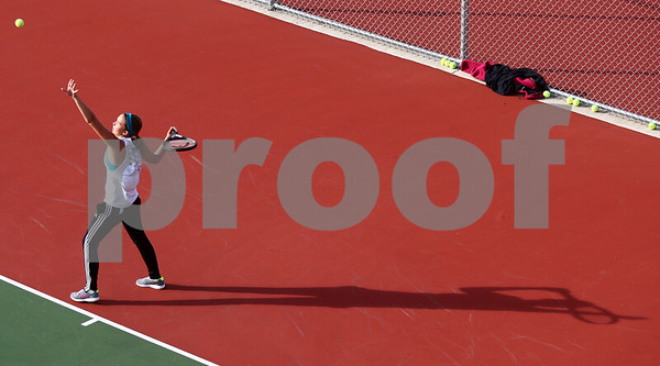 Kyle Bursaw – kbursaw@shawmedia.com<br /> <br /> DeKalb senior Taylor Volk (left) practices her serve during a one-on-one practice with assistant coach Michael O'Neill at DeKalb High School on Tuesday, Oct. 16, 2012.