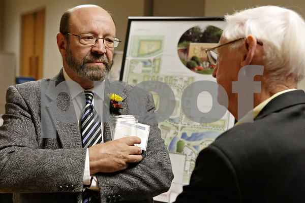 Rob Winner – rwinner@shawmedia.com<br /> <br /> Dave Juday (left), of Ideal Industries, speaks with Don Jones, of DeKalb Forge Company, during the DeKalb County Economic Development Corporation dinner event at Northern Illinois in DeKalb on Tuesday evening.