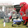 Rob Winner – rwinner@shawmedia.com<br /> <br /> Northern Illinois alumni John Joyce uses tongs to select a grilled bratwurst while tailgating outside Huskie Stadium in DeKalb before Saturday's homecoming game.