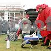 Rob Winner – rwinner@shawmedia.com<br /> <br /> Northern Illinois alumni John Joyce uses tongs to select a grilled bratwurst while tailgating outside Huskie Stadium in DeKalb before Saturday's homecoming game.