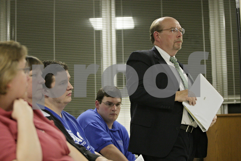 Rob Winner – rwinner@shawmedia.com<br /> <br /> Democrat Richard Schmack stands up after being introduced at the League of Women Voters of Dekalb County Candidates' Night at DeKalb City Hall Wednesday, Oct. 17, 2012.