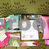 Kyle Bursaw – kbursaw@shawmedia.com<br /> <br /> The contents of one of Positively Pink Packages care packages that go to breast cancer patients includes an array of items from gift certificates, several books and documents, a personal letter, a pillow, socks, green tea and many other items. Seen at the Kishwaukee Community Hospital Cancer Center on Tuesday, Oct. 16, 2012.
