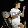 Rob Winner – rwinner@shawmedia.com<br /> <br /> Jacobs' Anthony Bux (right) heads a ball in front of DeKalb's Trevor Freeland in the first half of the Class 3A DeKalb Regional semifinal on Tuesday, Oct. 16, 2012. DeKalb defeated Jacobs, 1-0.