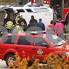 Kyle Bursaw – kbursaw@shawmedia.com<br /> <br /> Firefighters work to extract a man from an overturned van on the corner of Highway 23 and Barber Greene Road on Thursday, Oct. 18, 2012.