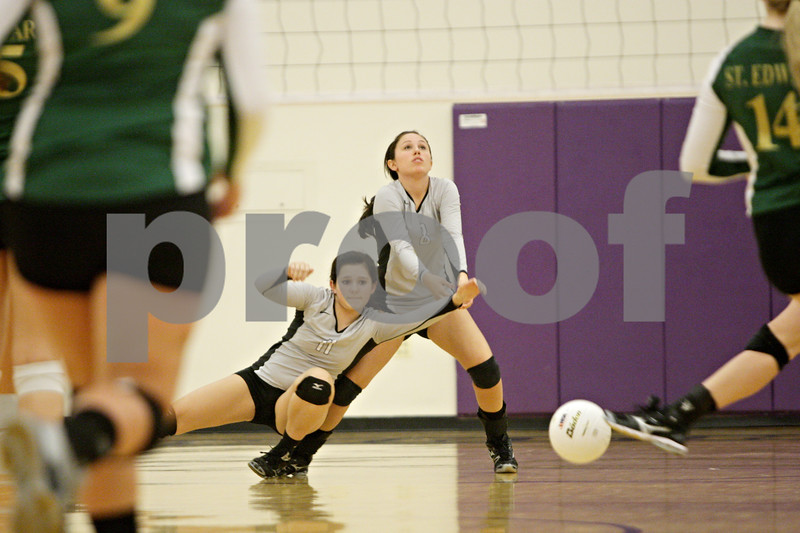 Rob Winner – rwinner@shawmedia.com<br /> <br /> Kaneland's Meredith McCaffrey (left) bumps into Casey Jacobson while going for a ball in the second game against St. Edwards during the Class 3A Hampshire Regional semifinals Tuesday, Oct. 23, 2012. Kaneland defeated St. Edwards, 25-17 and 25-18.