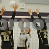 Rob Winner – rwinner@shawmedia.com<br /> <br /> Kaneland's Lyndi Scholl (6) attempts a kill as Sycamore's Ellyn Heegard (11) and Emily Young (2) try to block during the first game of the Class 3A Hampshire Regional final on Thursday, Oct. 25, 2012. Kaneland defeated Sycamore, 25-19 and 25-23.