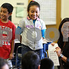 Kyle Bursaw – kbursaw@shawmedia.com<br /> <br /> Jackie Dugenia (right) laughs with second-graders in Sonia Enriquez's class as she prepares to whisper things for students Joesph Aburto (left) and Cristal Fuerte-Silva to act out during a CATCH lesson at Founders Elementary in DeKalb, Ill. on Wednesday, Oct. 24, 2012.